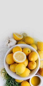 fresh lemons in a bowl.